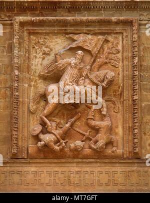 San Millan de la Cogolla, La Rioja, Spain. Yuso Monastery. Relief of Saint Emilian the Moor-Slayer by Spanish sculptor Diego Lizarraga, 1661-1665. Baroque portico, detail. - Stock Image