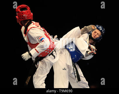 Russia's Tatiana Kudashova (blue) competes against Thailand's Phannapa Harnsujin in the Final of the Womens -53kg during Day 5 of the World Taekwondo Championships at Manchester Arena. - Stock Image