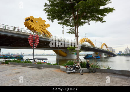 Dragon Bridge in Da Nang, Vietnam. The dragon's head spews out flames and sprays of water every weekend, and is a landmark to the city. - Stock Image