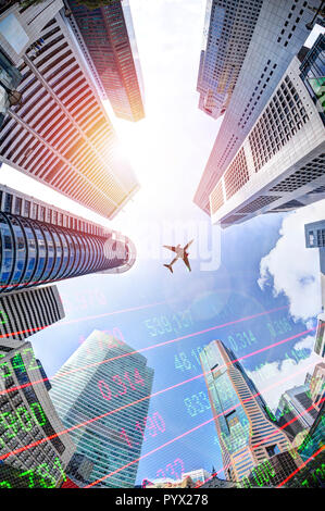 Business economy concept showing stock market ticker on modern office skyscraper buildings in Singapore's business and financial district with plane o - Stock Image
