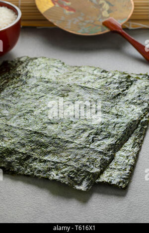 Sheets of dried green nori for cooking - Stock Image