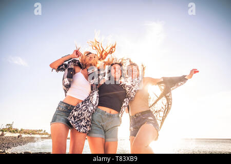 Young people having fun together - youthful friends beautiful cacuasian girls in summer clothes play and laugh a lot enjoying the summer holiday - Stock Image