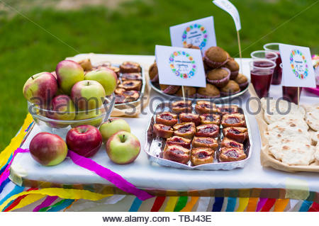 Small table with variation of baked food and fresh - Stock Image