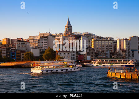 The beautiful view of the Galata Tower and Golden Horn at sunset, Istanbul, Turkey - Stock Image