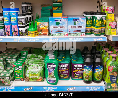 A selection of pest control products for slugs in a garden centre in Britain - Stock Image