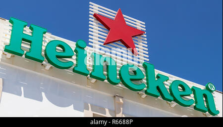ALBUFEIRA, PORTUGAL - JULY 13TH 2018: The Heineken logo above a cocktail bar in the old town area of Albufeira in Portugal, on 13th July 2018. - Stock Image