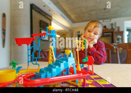 A six year old boy playing Mouse Trap board game - Stock Image