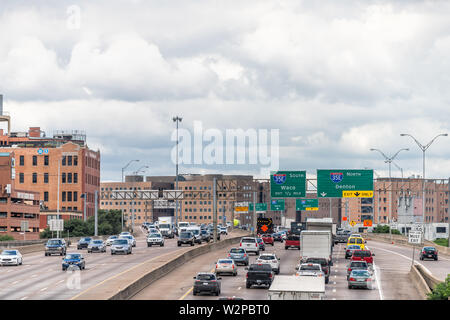 Dallas, USA - June 7, 2019: High angle view of highway in city in summer with Woodall Rodgers Freeway and traffic with cityscape and signs - Stock Image