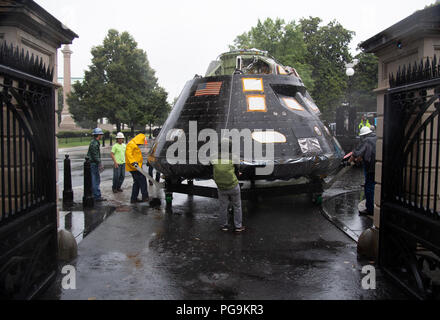 NASA's Orion spacecraft that flew Exploration Flight Test-1 on Dec. 5, 2014 is seen while being moved into position to be lifted over a gate and onto the South Lawn of the White House, Saturday, July 21, 2018 in Washington, DC. Lockheed Martin, NASA's prime contractor for Orion, began manufacturing the Orion crew module in 2011 and delivered it in July 2012 to NASA's Kennedy Space Center where final assembly, integration and testing was completed. More than 1,000 companies across the country manufactured or contributed elements to the spacecraft. - Stock Image
