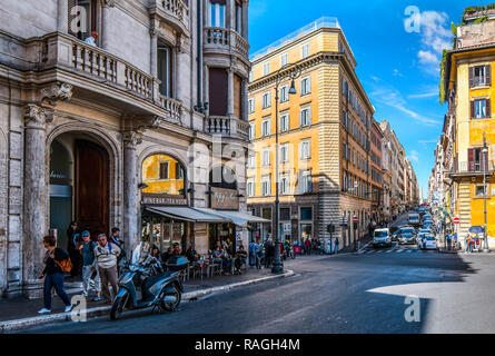 Rome, Italy - September 29 2018: Tourists enjoy lunch at a sidewalk cafe on a busy intersection in the historic center of Rome, Italy. - Stock Image