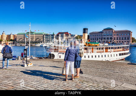 18 September 2018: Stockholm, Sweden - Tourists sightseeing in Gamla stan, the old town of Stockholm, on a beautiful autumn morning, with a view to th - Stock Image
