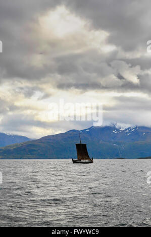 A traditional wooden Nordland boat is sailing on Ofotfjorden  in northern Norway. - Stock Image