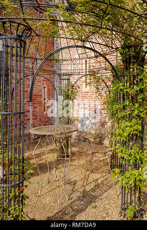 Elegant antique patterned iron garden furniture set, high table and chairs - Stock Image