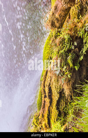 Under waterfall in the mountain. - Stock Image