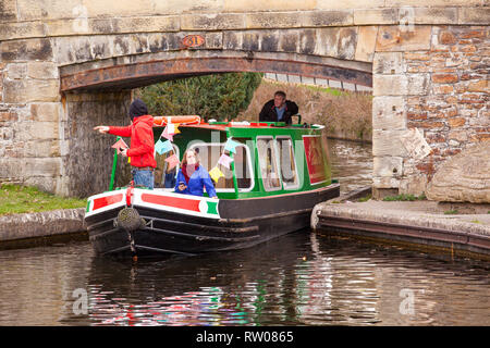 People men and women on a narrow boat on the Llangollen canal at Trevor basin near Wrexham North Wales - Stock Image