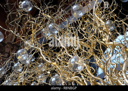 Golden gold painted curly branches and glass baubles Christmas decorations outside the Leadenhall office building City of London UK  KATHY DEWITT - Stock Image