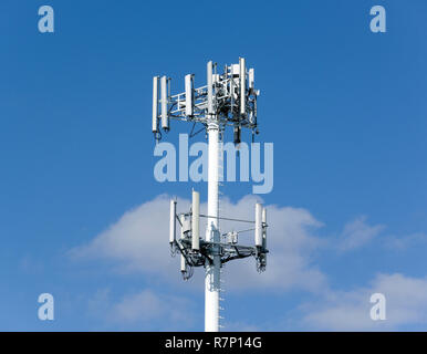 Cell phone antennas on tower. - Stock Image