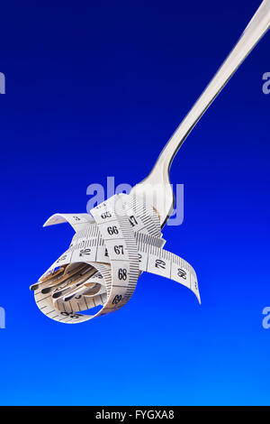 Fork with Tape Measure, Dieting Concept Obesity - Stock Image