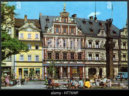 GERMANY - CIRCA 1970: A postcard printed in Germany, shows a Haus zum Breiten Herd on the Fishmarkt, Erfurt, circa - Stock Image