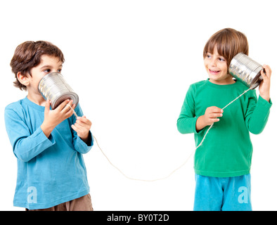Two boys talking on a tin can phone isolated on white - Stock Image