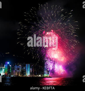 The National Day fireworks dwarf the 415m tall International Finance Centre in Hong Kong - Stock Image