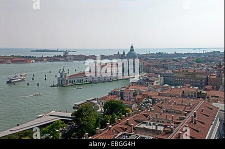 View from St Marks Bell Tower Venice of Grand Canal Basilica di Santa Maria della Salute and the island of La Giudecca - Stock Image
