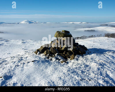 Snowy summit cairn, Langlaw hill, near Broughton, Southern Uplands, Scotland - Stock Image