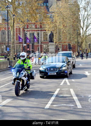 London, England, UK. The Prime Minister's cars and motorcylce outriders driving through Parliament Square - Stock Image