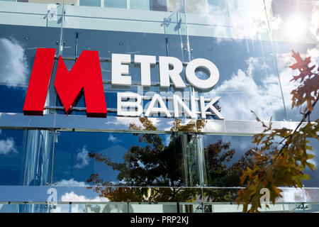 The Metro Bank company logo displayed on the outside of a new branch on the High Street  in central Bristol, Uk - Stock Image