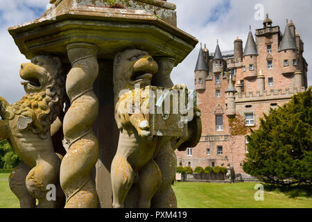Close up of damaged Lion sculptures of The Great Sundial on the front lawn of Glamis Castle Scotland UK - Stock Image