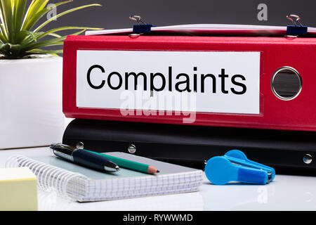 Close Up Of Compliance Folder And Office Supplies On Office Desk - Stock Image