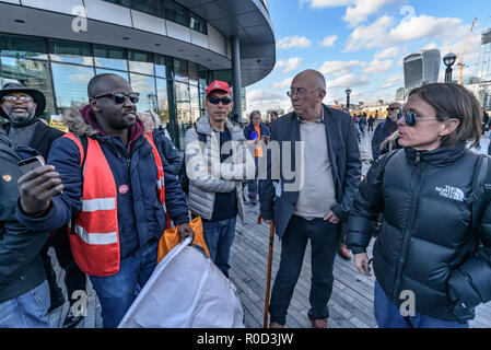 London, UK. 3rd November 2018. Ian Bone and Sid Skill of Class War argue with a Labour supporter. Class War came to the 'No Demolitions Without Permission' housing protest at City Hall with banners declaring that Labour Councils were the biggest social cleansers in London and 'Labour, Labour Home Snatchers! Even Worse Than Maggie Thatcher', pointing out that it was largely Labour councils who were demolishing council estates so that developers could replace council houses with large numbers of properties sold at high market prices and a miserably small number of homes at social rent, promoting - Stock Image
