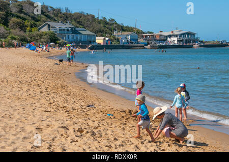 Children playing on a summer morning at Half Moon Bay on Port Phillip Bay, Melbourne, Australia - Stock Image