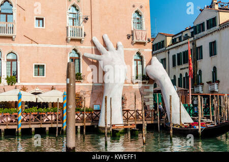 Giant hands sculpture rise from the water in Venice to highlight climate change - Stock Image