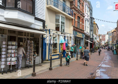 People walking along George street at Hastings old town, East Sussex, England , UK - Stock Image