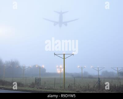 Weather in Glasgow, Scotland, UK, Europe. 23rd, December, 2018. A plane attempts to land in thick fog at Glasgow International airport - Stock Image