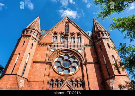 Evangelical Church of the Holy Cross on Blücherplatz, Kreuzberg-Berlin. Historic brick church also used for cultural events - Stock Image