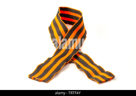 Ribbon of Saint George, a Russian military symbol consisting of a black and orange bicolour pattern, on a white background - Stock Image