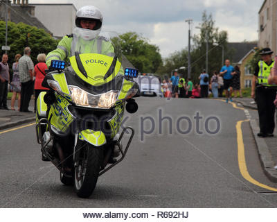 Police Scotland Motorcycle Police Officer on a bike with its blue lights flashing. - Stock Image