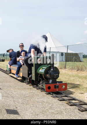 Steam train ride at Wings and Wheels - Stock Image