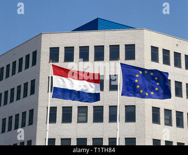 The Dutch national flag together with the flag of the European Community - Stock Image