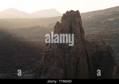 Scenic view of rock formation against landscape - Stock Image