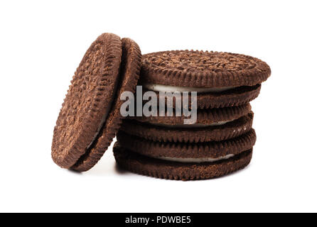 Chocolate cookies with creme filing isolated on a white background - Stock Image