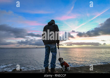 Newlyn, Cornwall, UK. 19th Feb, 2019. UK Weather. It was a mixture of sunshine and sharp showers at sunrise in the far south west of Cornwall at Newlyn. Credit: Simon Maycock/Alamy Live News - Stock Image