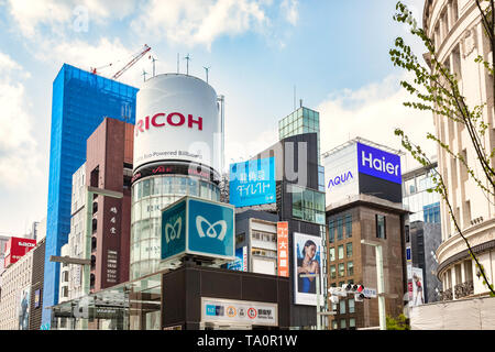 7 April 2019: Tokyo, Japan - Metro logo in front of massed skyscrapers in the Ginza district, downtown Tokyo. - Stock Image
