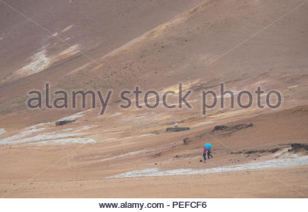 Tourists at the Hverarond mud pots. - Stock Image