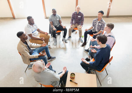 Men praying in circle in prayer group - Stock Image