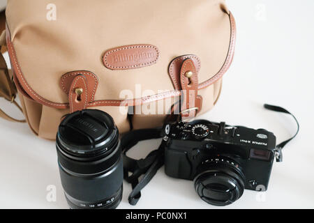 Billingham camera bag with retro style Fuji mirrorless camera and lenses - Stock Image