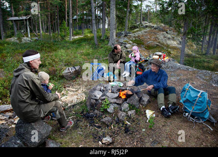 Family cooking outdoors - Stock Image