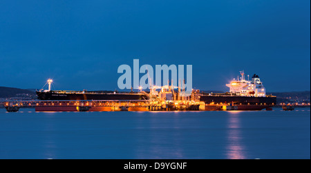 Oil tanker berthed at Hound Point on the Firth of Forth at night, Scotland - Stock Image